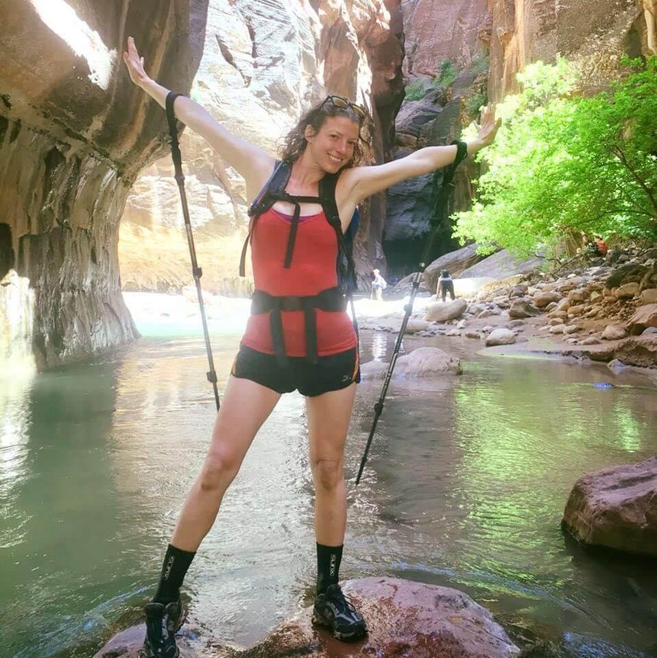 Megan with hiking poles in a canyon in the American Southwest
