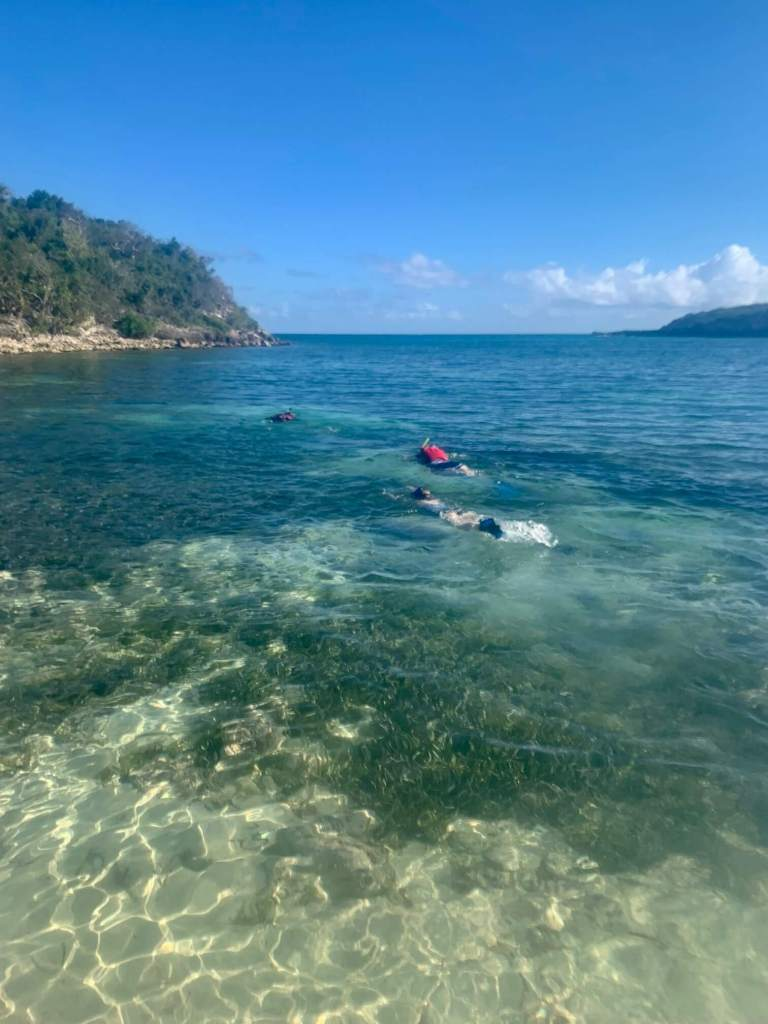 AB, Mom, and Gwen swimming away on their snorkel adventure