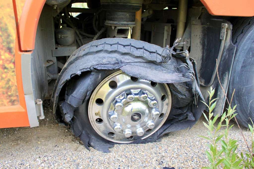 Shredded tire on a motorcoach