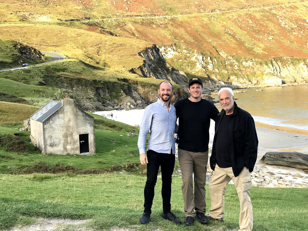 Max with his brother and dad along the rocky Irish coastline