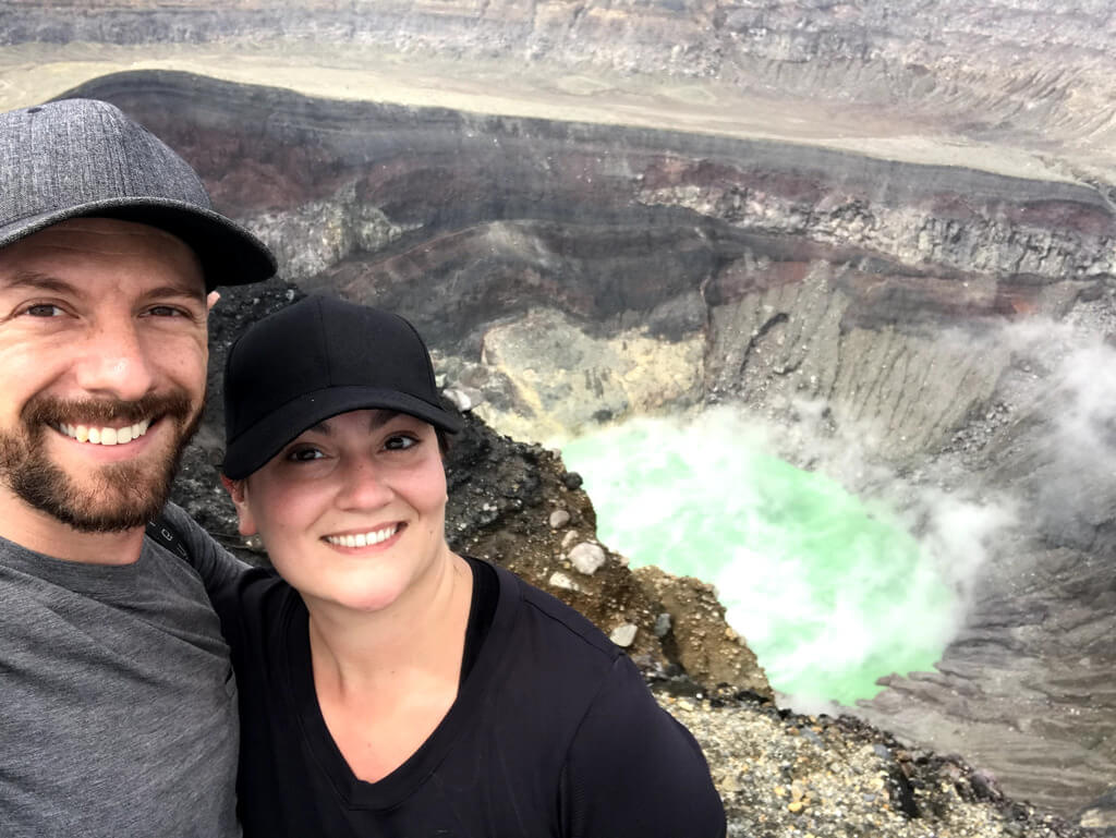 Max and a friend in front of a volcanic crater in El Salvador