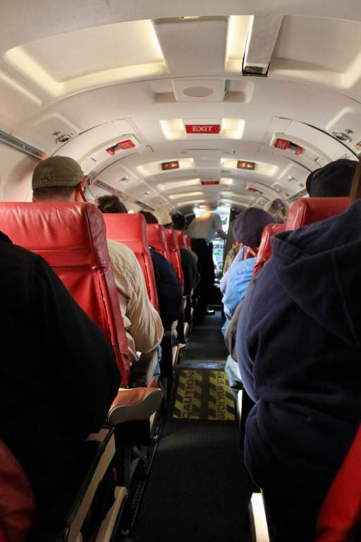 Interior of a small plane with one seat on each side