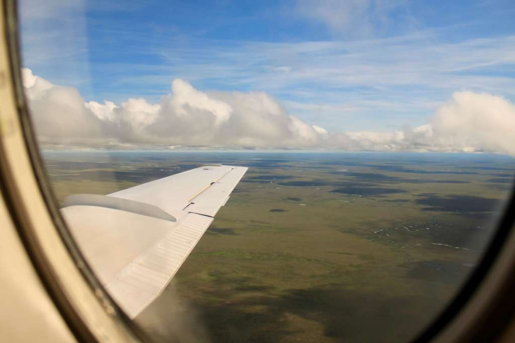 Aerial view of vast expanse of flat green tundra