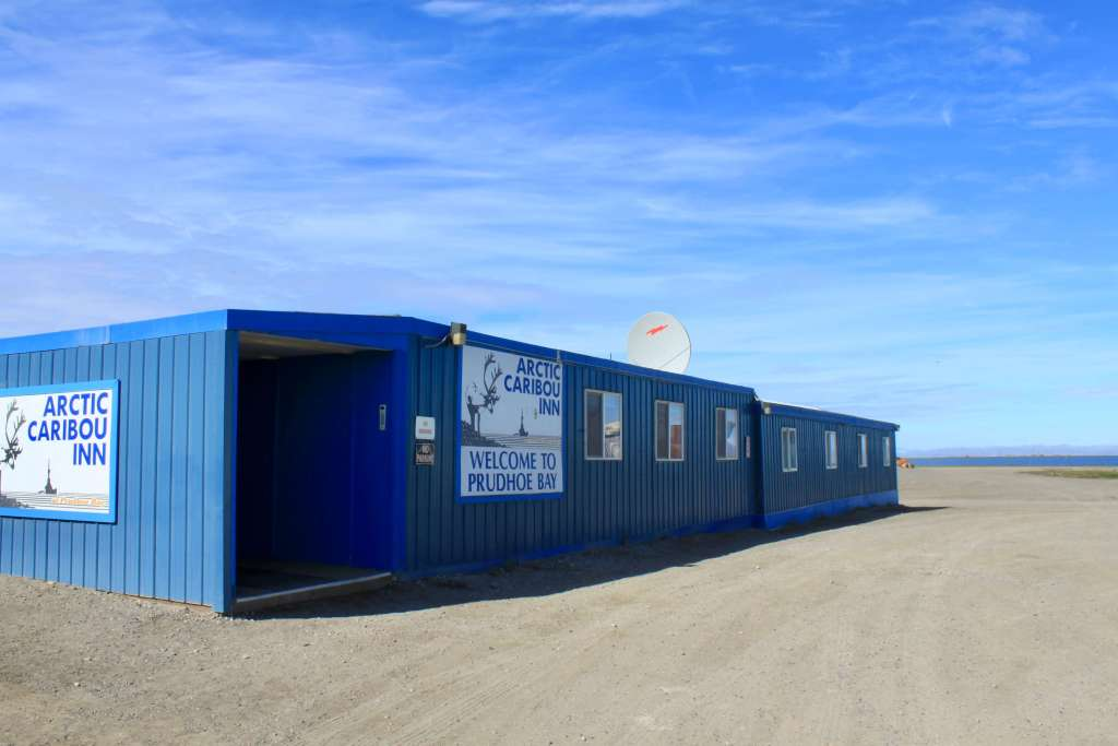 The blue, spartan Arctic Caribou Inn in Deadhorse at the top of the Dalton Highway in Alaska