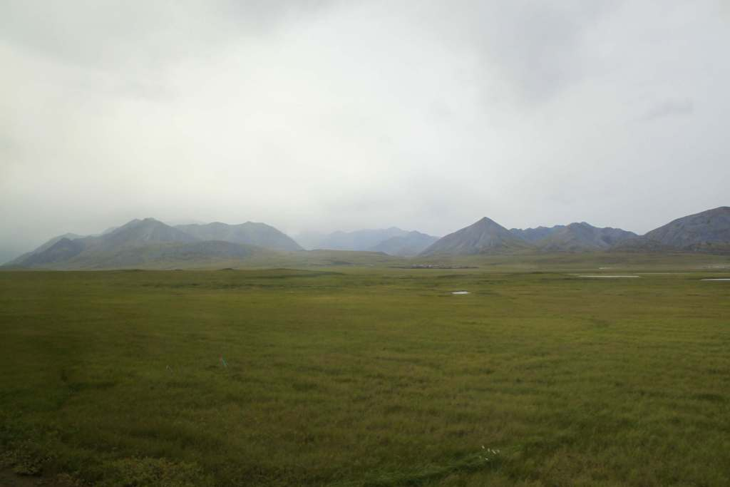 Foothills of the Brooks Range shrouded in clouds as seen from the Dalton Highway in Alaska