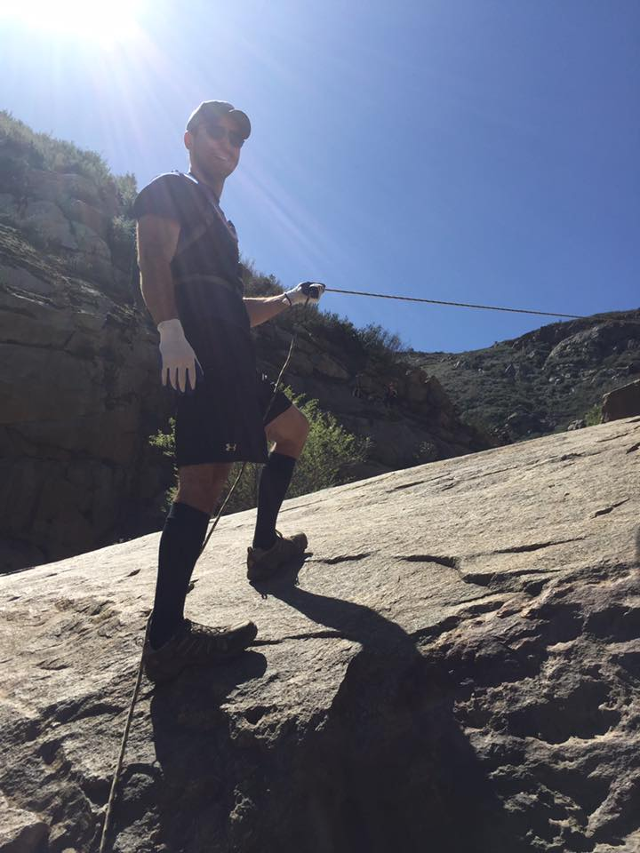 Chad using ropes to assist with the climb