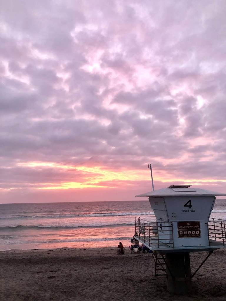 Lifeguard tower looking out over a pink sunset