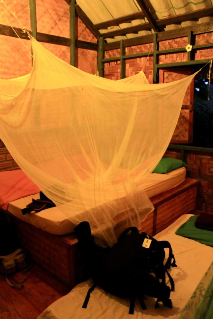 Mattresses and mosquito netting inside our bungalow
