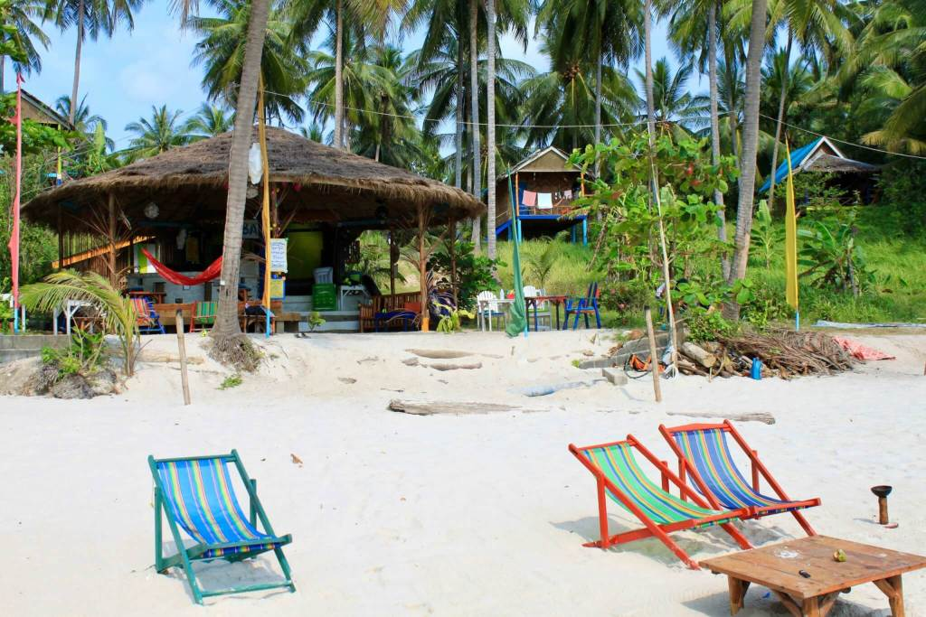 Thailand beach bar with chairs in the sand