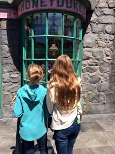 Performing spells in the window of Honeydukes.