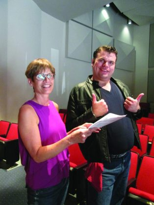 Steven Matthew Brodnick, rehearsing his lines with Rose Stauffer, gives the play two thumbs up.