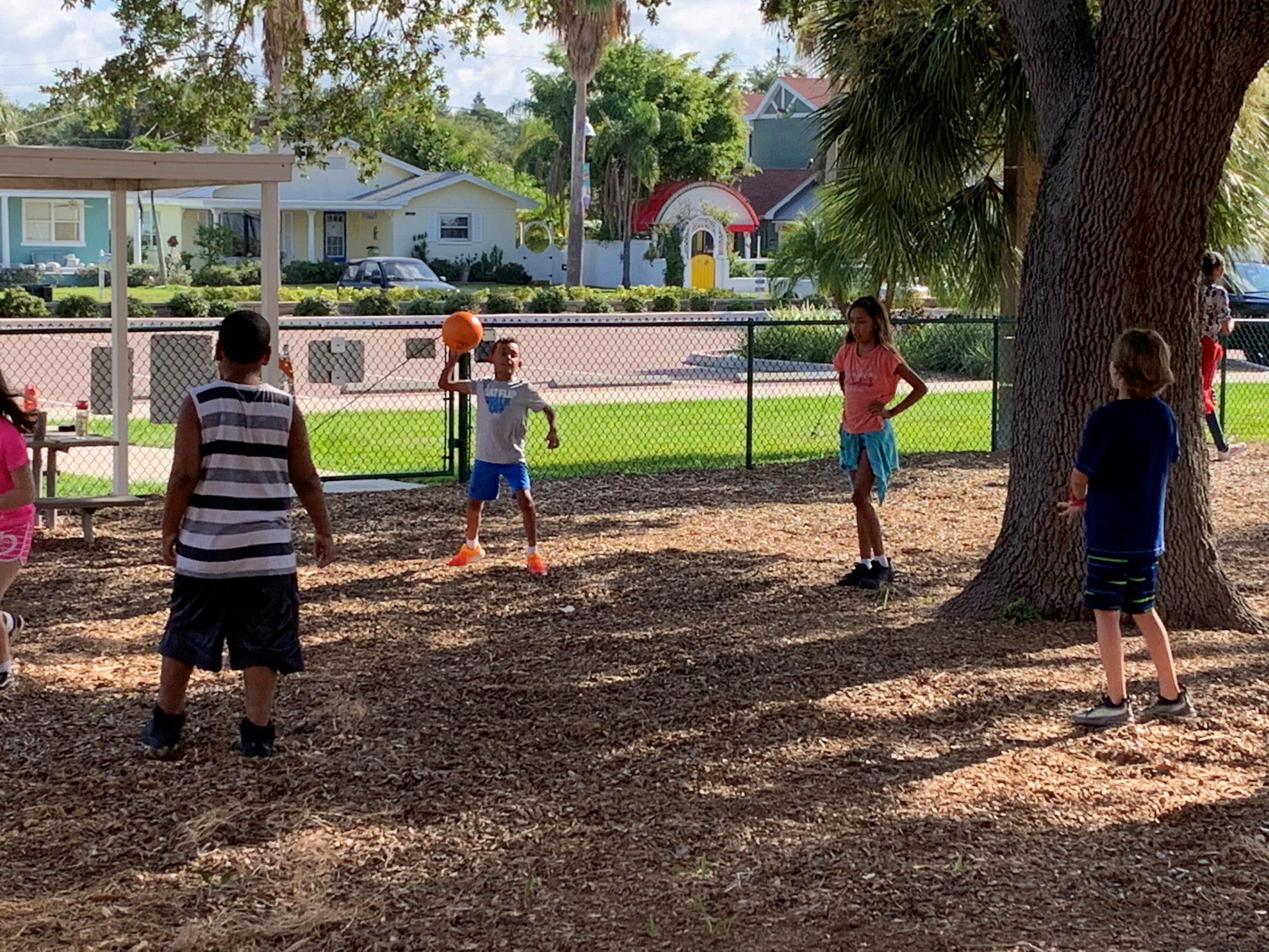 Kids play dodgeball outside Gulfport florida