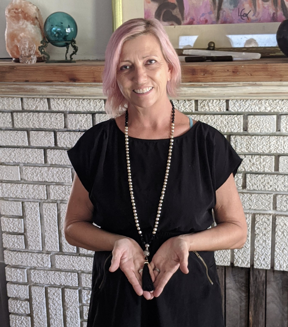 Lisa Taylor holding handmade male necklace.