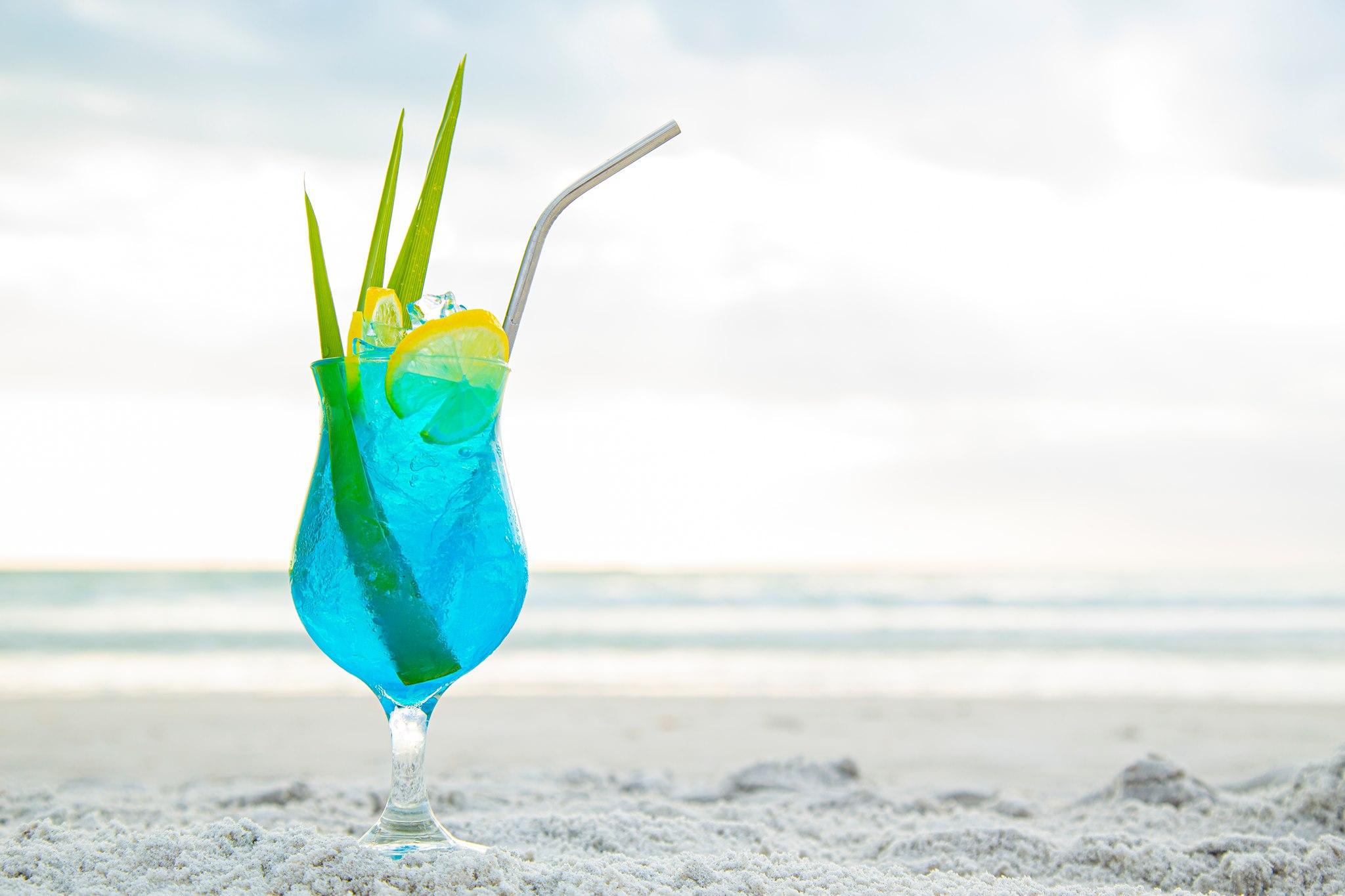 A blue drink on the beach