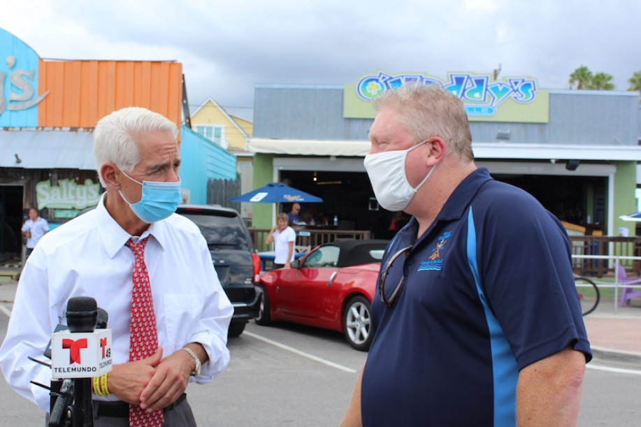 Congressman Charlie Crist, left, speaks with Gulfport Mayor Sam Henderson in a press conference outside O'Maddy's in Gulfport on Wednesday, August 12.