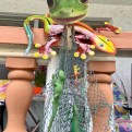 Gecko art with fish net on a balcony.