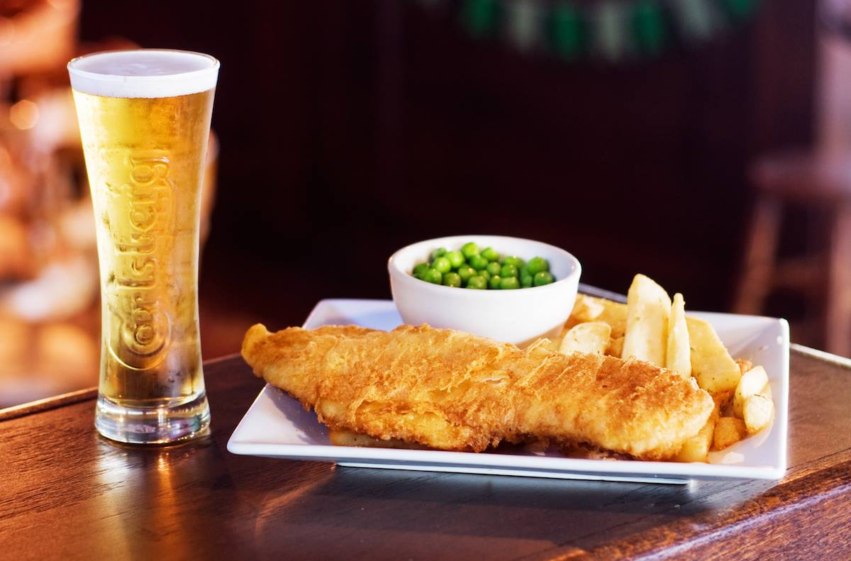 Fish and chips with peas and a pint of beer