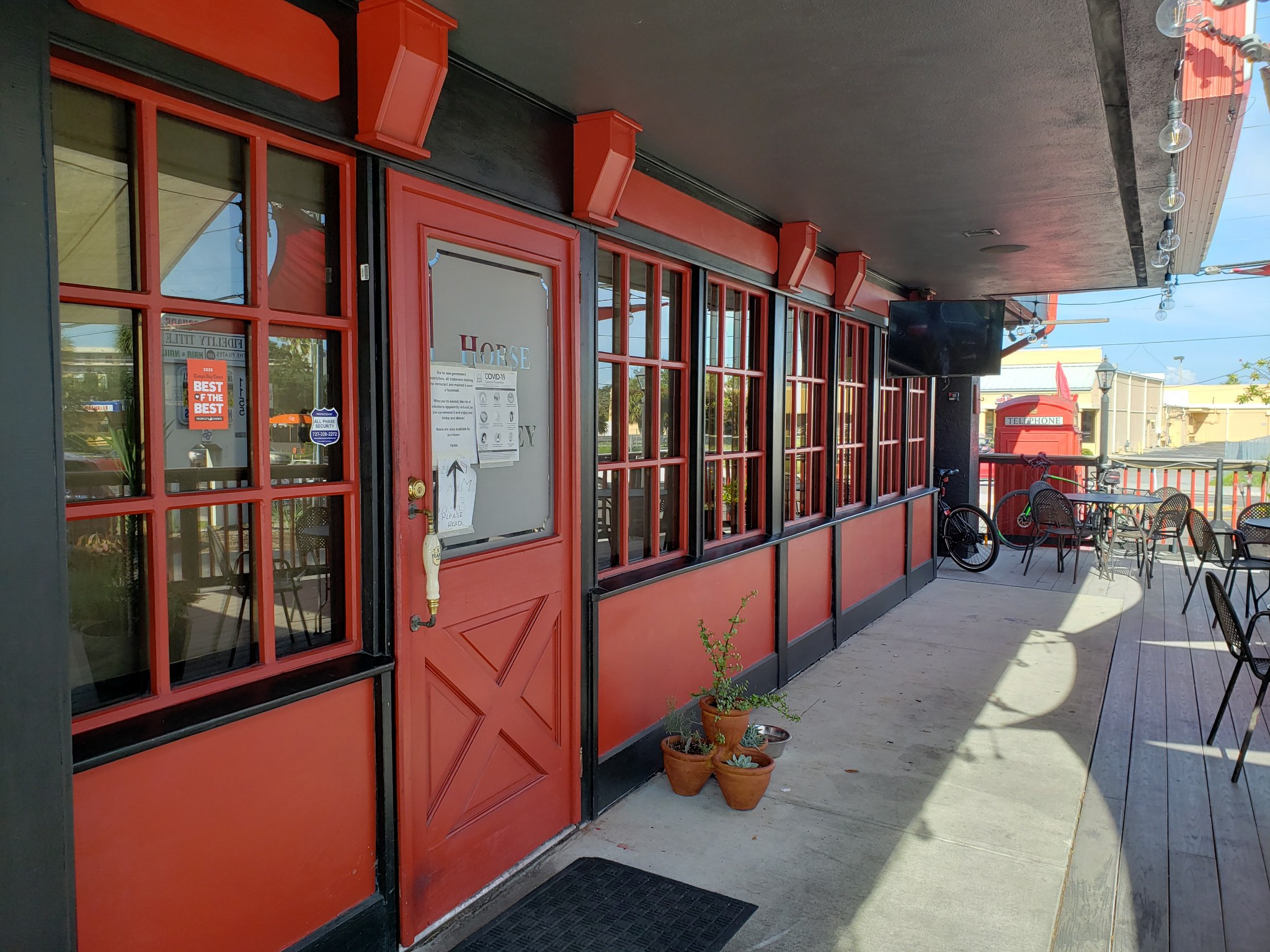 Front entrance red panelling of Horse and Jockey Pub
