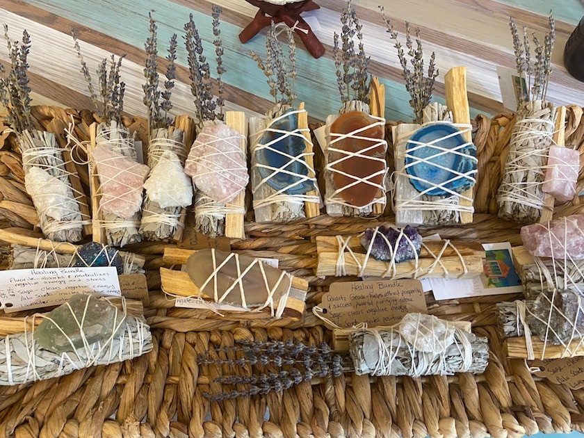 A collection of soaps and sage bundles for sale at a Gulfport Florida market.