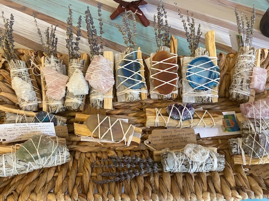A collection of soaps and sage bundles for sale at a local market.
