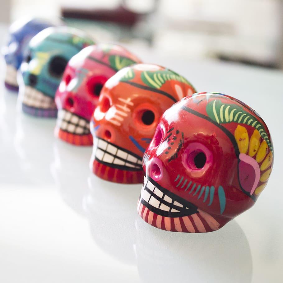 Day of the Dead row of sugar skulls via pxfuel