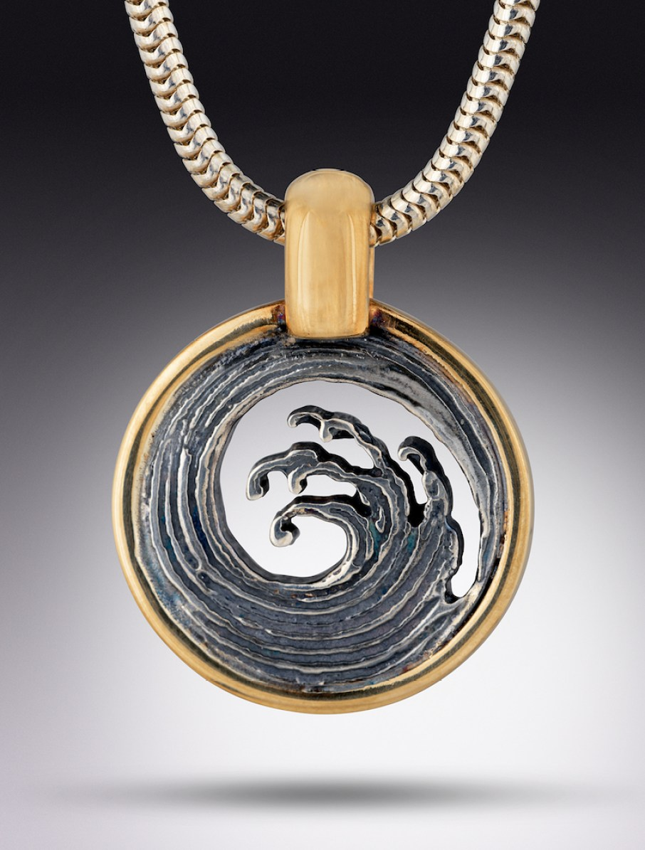 A circular wave pendant on a chain