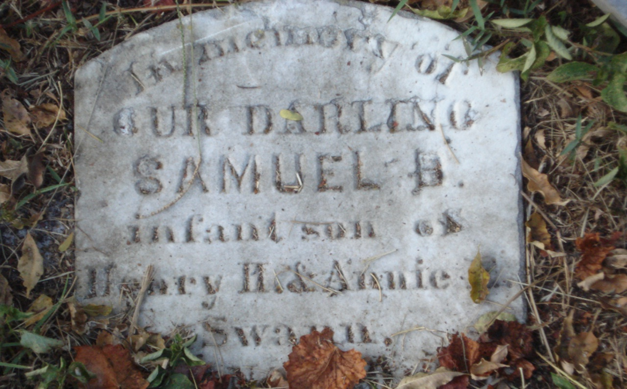 A close up shot of an old gravestone