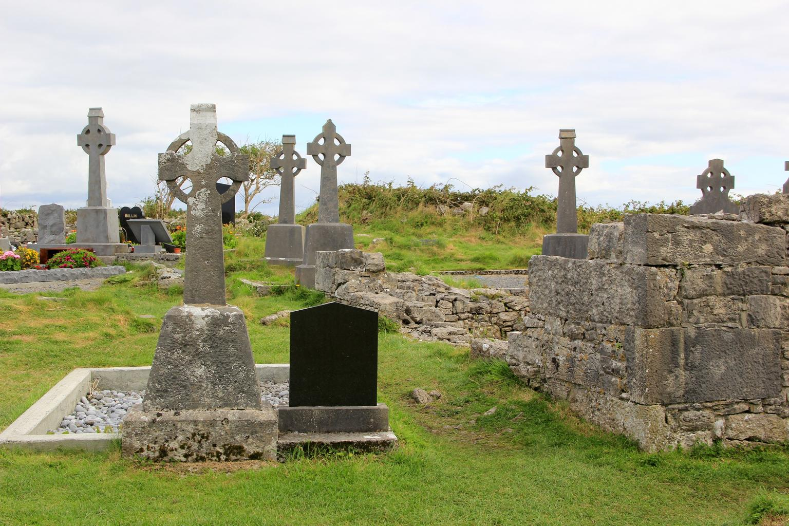 A cemetery with Celtic cross gravestones