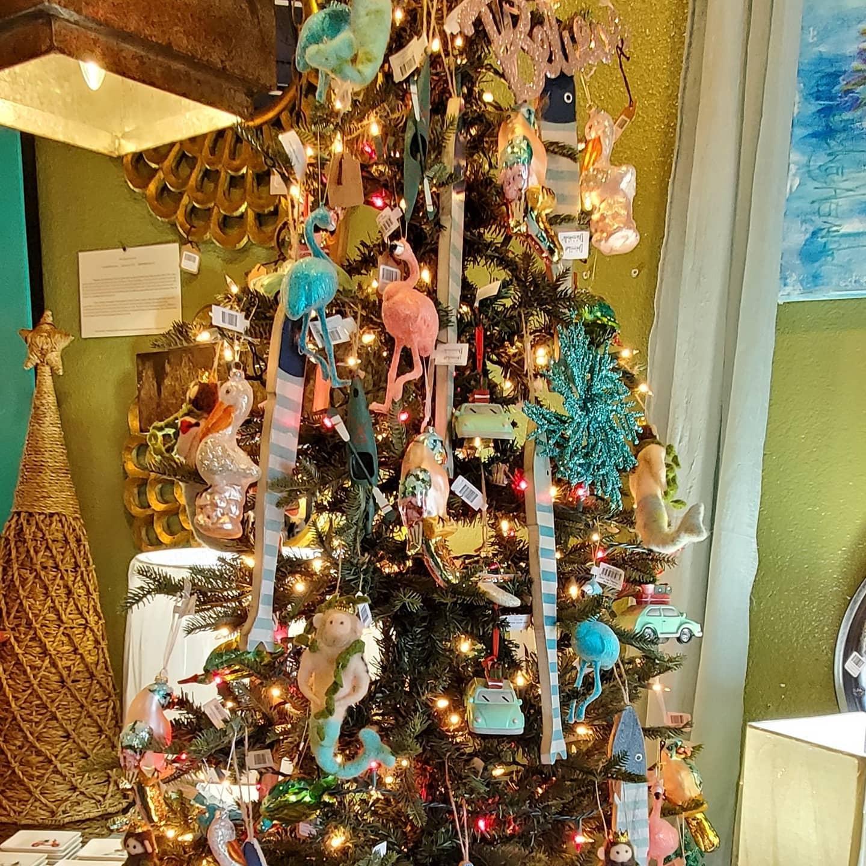 A holiday tree with artsy ornaments.