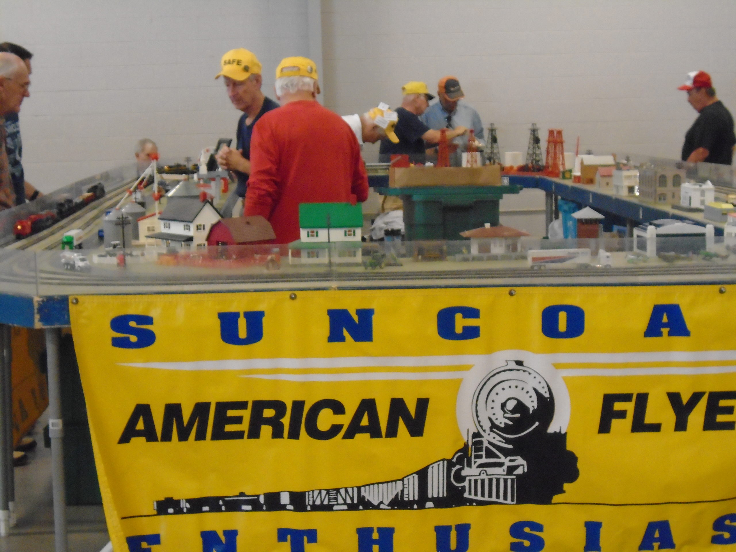 train show image of vendor with yellow banner on table via Regal Railways