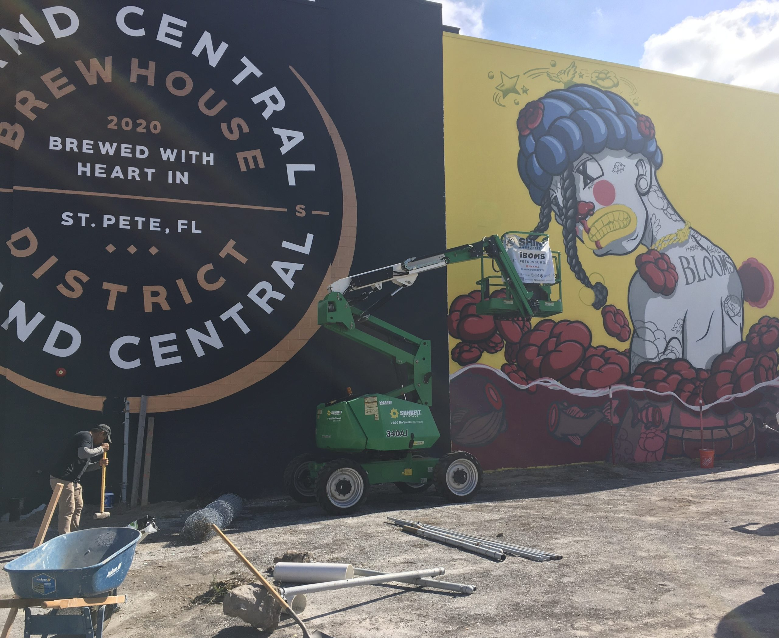 A mural outside of a coffee shop in black and yellow.