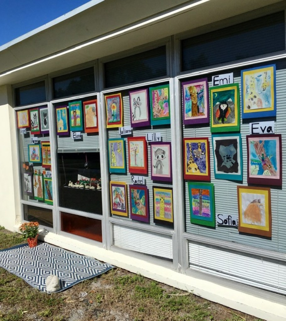 A wall of children's drawings.