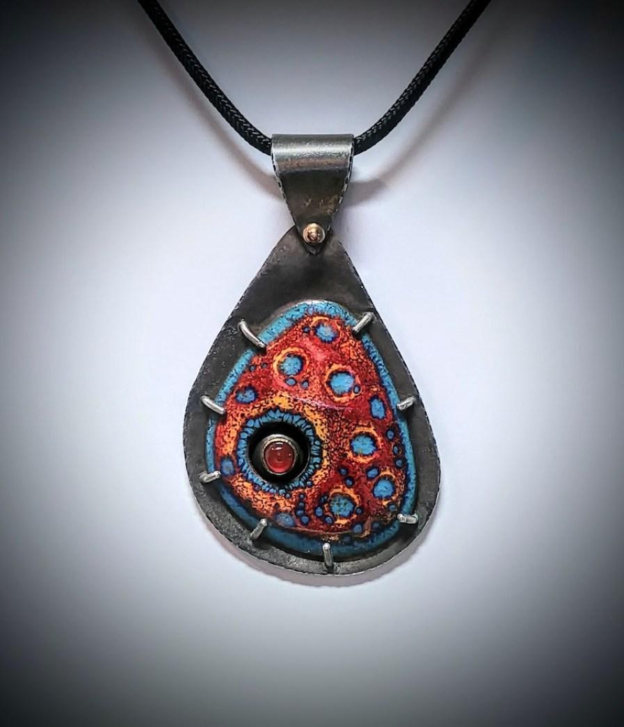 An abstract art pendant.