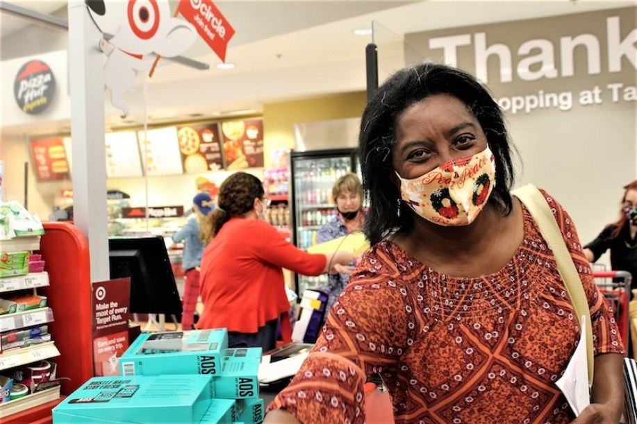 A woman in a face Mask shopping at Target.