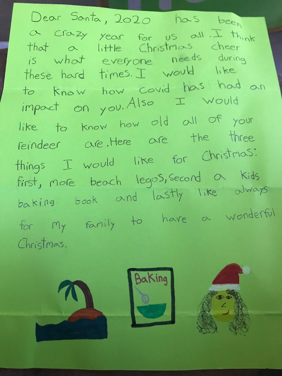 A child's letter to Santa on green paper with drawings at the bottom.