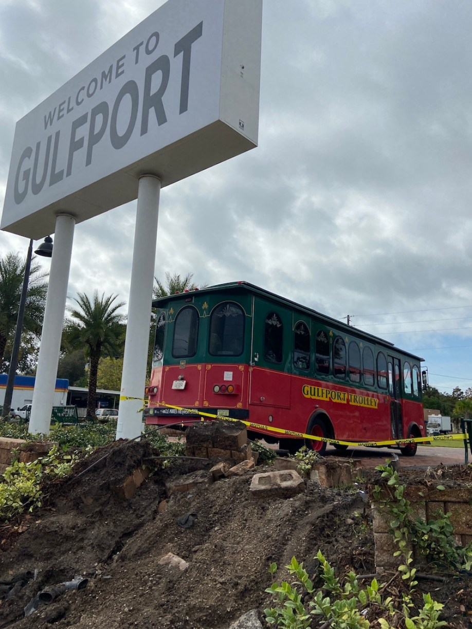 """A trolley and sign that says """"Welcome to Gulfport"""""""