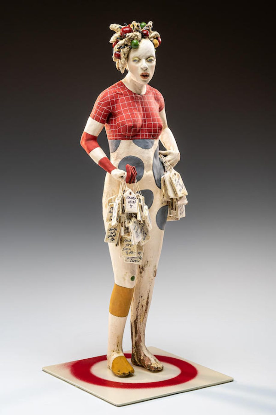 A sculpture of a woman in red and white