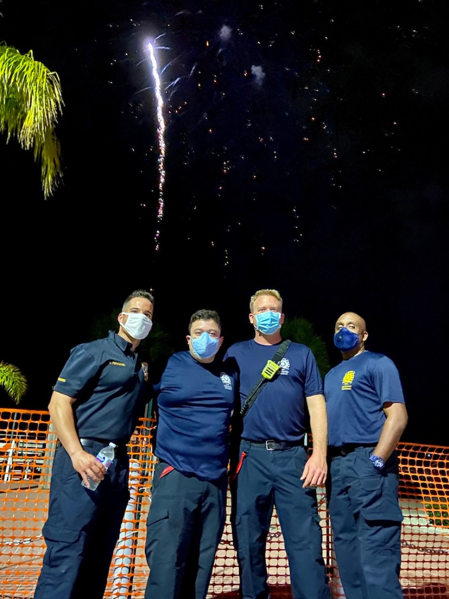 Four Firefighters in blue wearing face masks