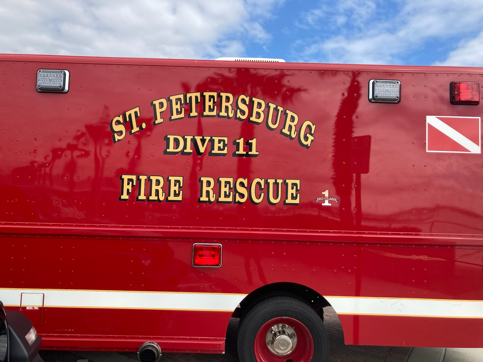 """A close up of a red fire rescue vehicle that reads """"St. Petersburg Dive 11 Fire Rescue"""""""