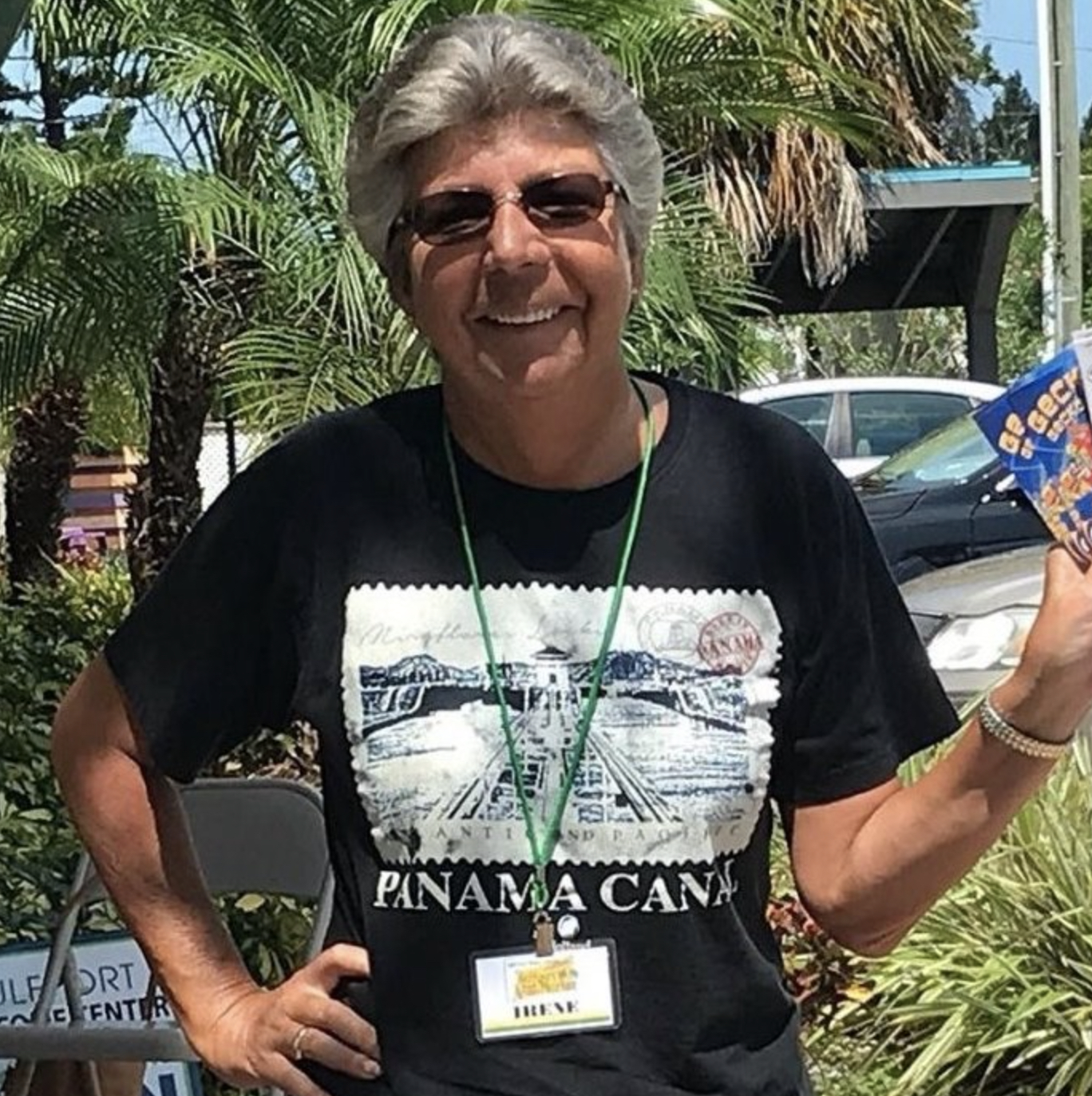 """A woman in a t-shirt that says """"Panama Canal"""" in sunglasses"""