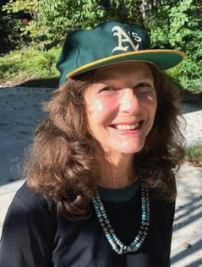 A woman in an Oakland As baseball cap.