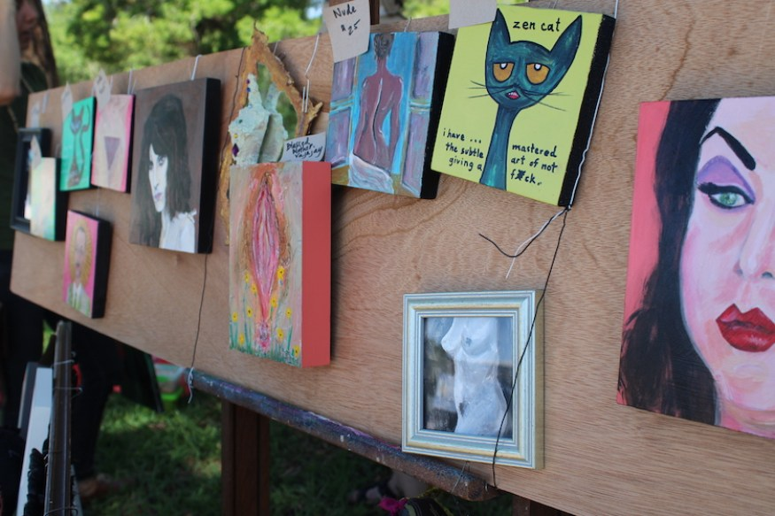 An outside display of art and photographs.
