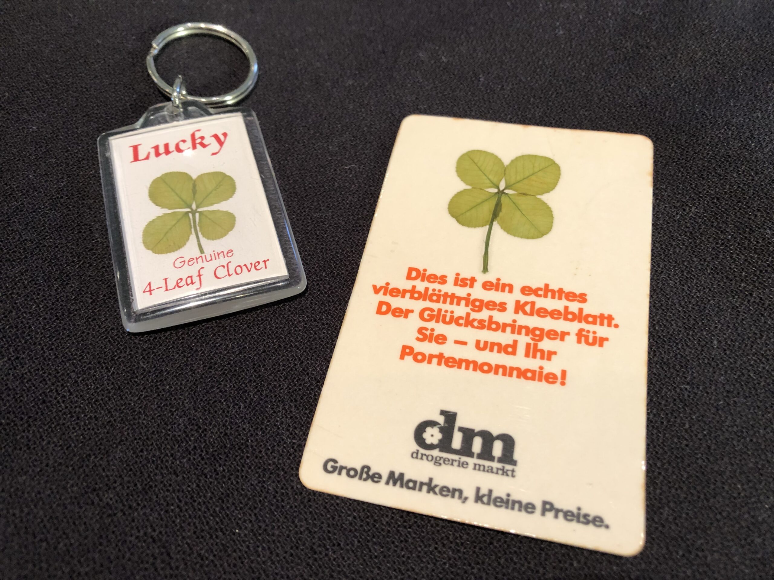 A key chain and good-luck charm with four-leaf clovers and German writing