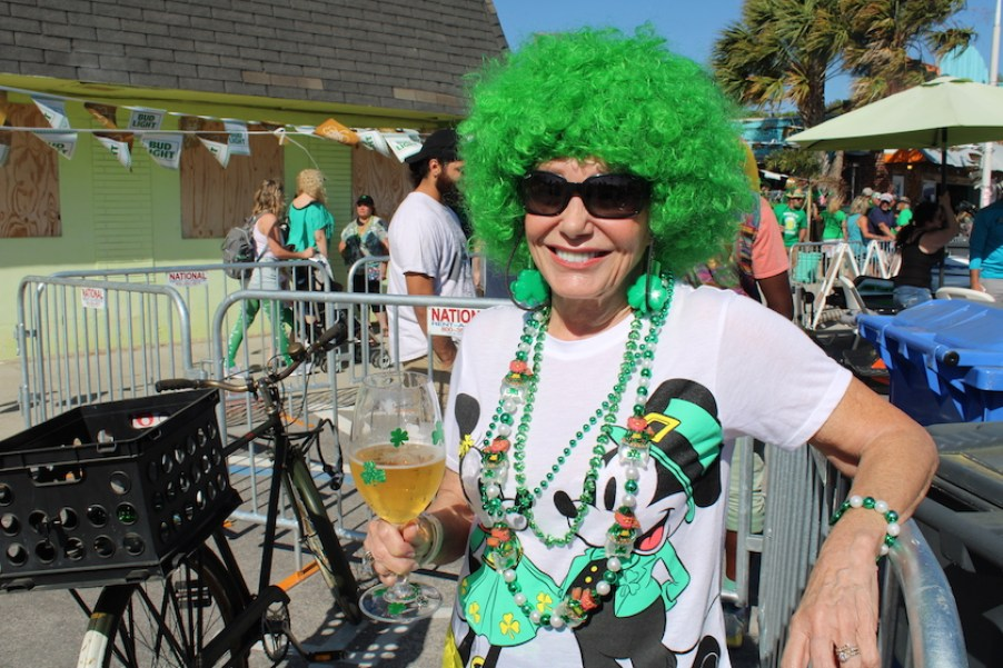 A woman on the street in St. Patrick's Day costume