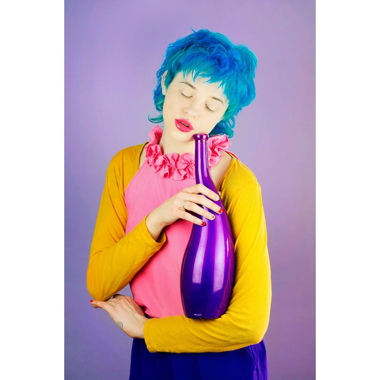 A colorful photo of a woman with blue hair holding a purple vase