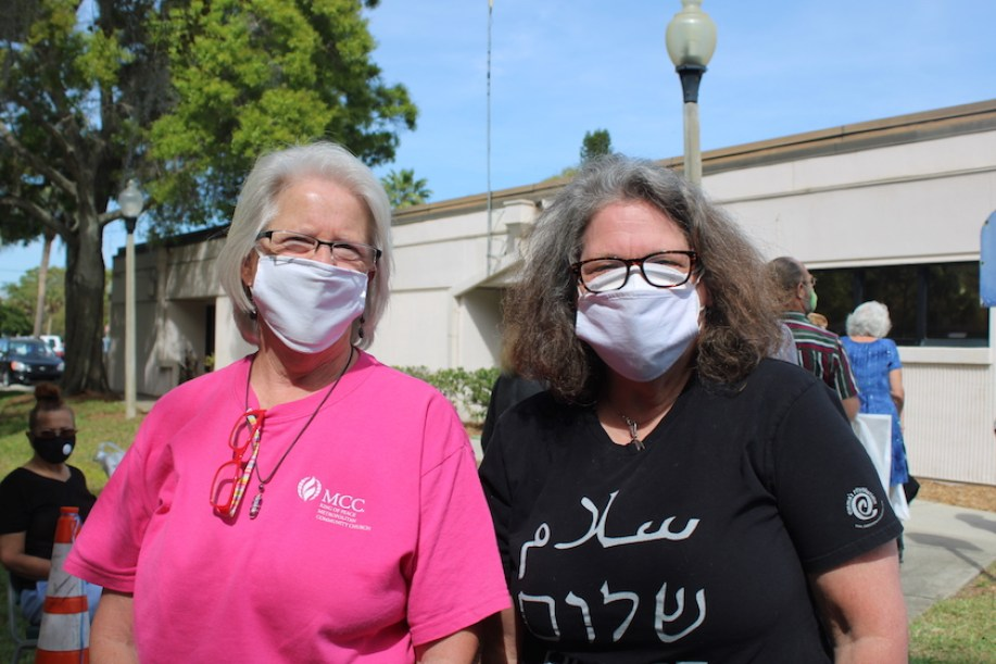 Two women outside with face masks on looking at the camera