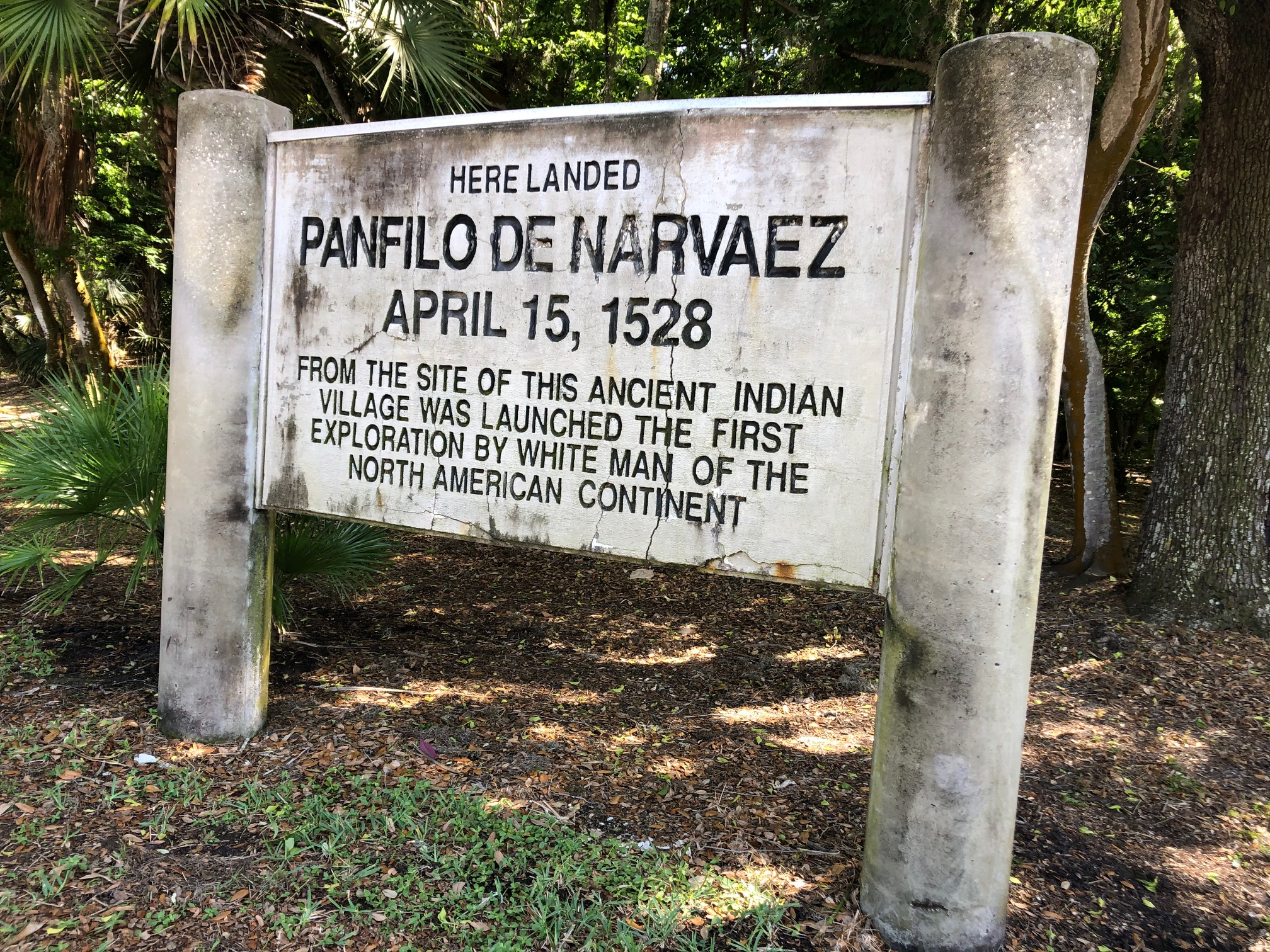 """A historic marker sign that reads """"Here landed Panfilo De Narvaez"""" April 15, 1528 From the site of this ancient Indian village was launched the first exploration by white men of the North American continent."""""""