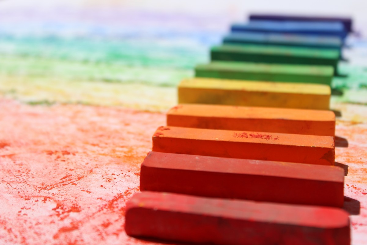 Rainbow blocks laying on colored cement