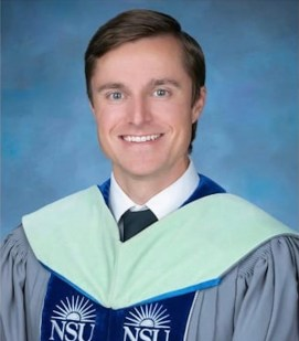 A head shot of a young man in a graduation gown.