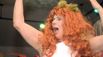 Women in red wig dancing
